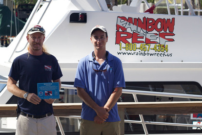 Rainbow Reef Dive Center staff proudly display their new Blue Star decal.
