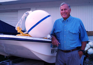 John Halas with a mooring buoy